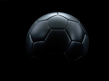 Black Football Against Black Background.