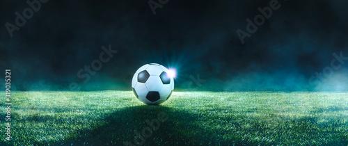 Stampa su Tela Football on an illuminated empty sports field at night