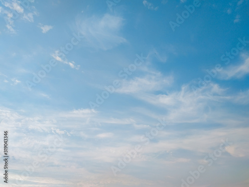 cloudscape with white altocumulus clouds at evening Canvas Print