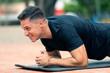 Leinwanddruck Bild - Young man exercising outdoors.