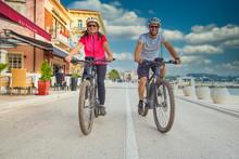 Active Couple Riding An E-Bike...