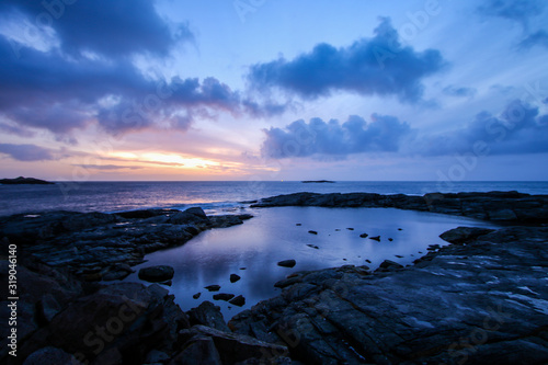 Rocky coastline with a natural pool in the small fishing village of A (Moskenes) Wallpaper Mural