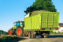 Tractor With Trailer Full Of Hay On The Road In Bourgogne-Franche-Comte Region, France.