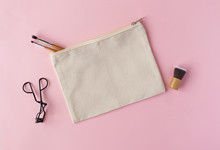 Blank Canvas Make Up Bag On A Pink Background Surrounded By Brushes Mockup - Make Up Case Template Flat Lay