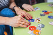 Process of playing board game and having fun with friends and family, board game concept, hand playing and roll the dice