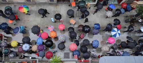 Fotografie, Tablou High Angle View Of People With Umbrella Standing On Street During Rainy Season