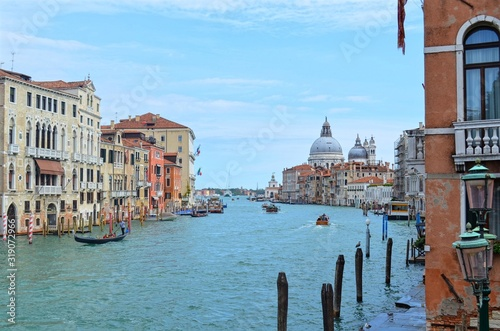 Fototapeta panoramic view of the wide Venetian canal, with the domes of the Basilica Della Salute in the background obraz na płótnie