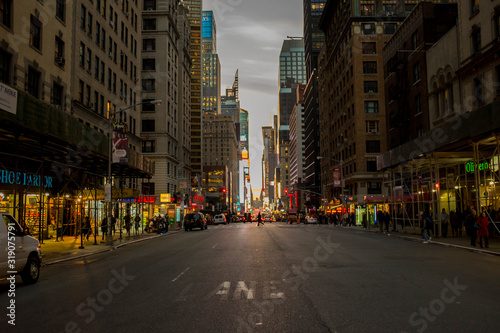 CITY STREET AMIDST BUILDINGS AGAINST SKY - fototapety na wymiar