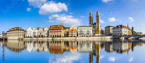 Fototapeta Reflection Of Buildings In River Against Sky obraz