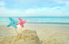 Bright Windmill Toy On Sea Bea...