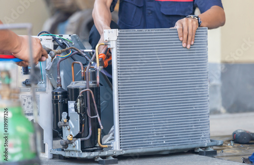 Obraz Close up of Air Conditioning Repair team use fuel gases and oxygen to weld or cut metals, Oxy-fuel welding and oxy-fuel cutting processes, repairman on the floor fixing air conditioning system - fototapety do salonu