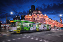 Melbourne, Victoria / Australia - January 26 2020: Flinders Street Station And Church With Light Trails, Car Trails, Trams, Cars And Tourists At Blue Hour