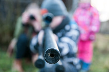 Close-Up Of Person Aiming Gun While Standing Outdoors