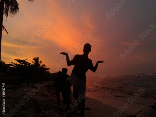 Fototapety, obrazy: Silhouette Man Posing At Beach Against Sky During Sunset