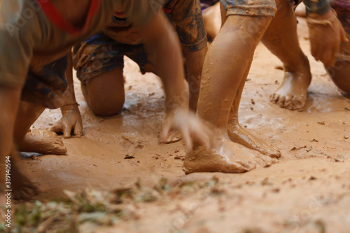 Low Section Of People Playing In Mud