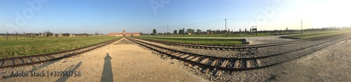 Panoramic View Of Railroad Tracks And Land