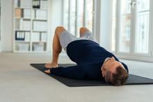 Man Doing Exercises, Lying On ...