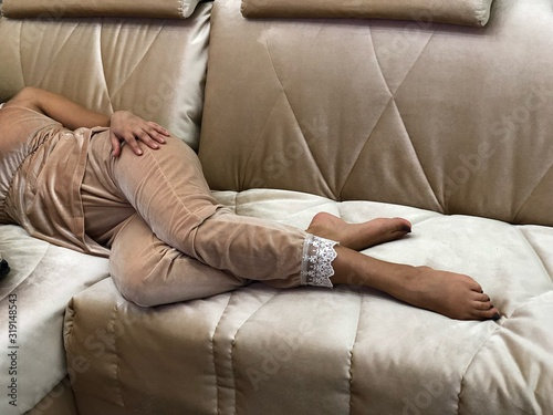 Fototapety, obrazy: Low Section Of Woman Relaxing On Sofa At Home