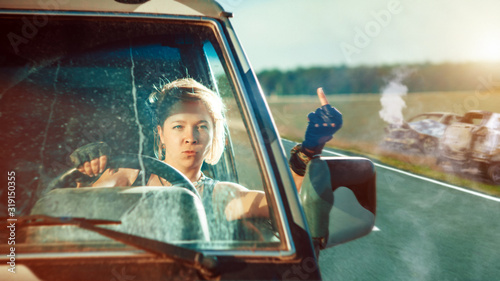 Blond soldier woman in uniform is driving military vehicle. Tapéta, Fotótapéta