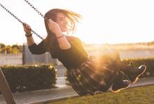 Girl Having Fun On The Swing -...