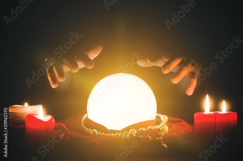 Vászonkép Crystal ball and fortune teller hands close up.