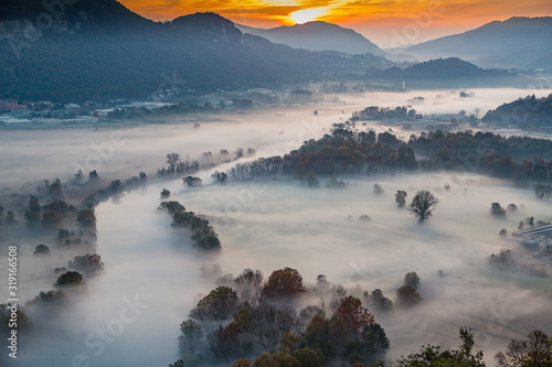 Photo Sunrise view with fog on the Adda River-Italy