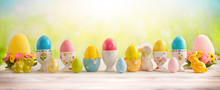 Easter Concept With Colorful Decorated Eggs In Egg Cups And Flowers