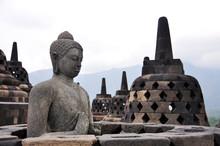 Buddha Statue And Stupas At Borobudur Against Sky
