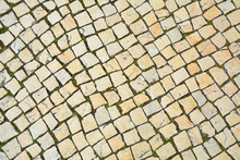 Lisbon Pavement Made Of Limestone Squares Background