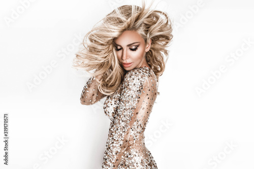 Blonde girl with long and shiny wavy hair Fototapet