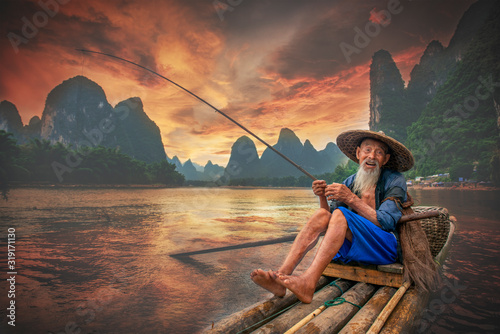 Tablou Canvas Portrait Of Man Fishing In Lake Against Sky During Sunset