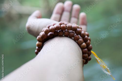 Fotografie, Obraz Cropped Hand Wearing Bracelet