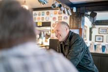 Man Enjoying His Beer In British Pub