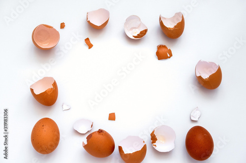 top view flat lay frame with  brown eggs and egg shells on a white background wi Canvas Print
