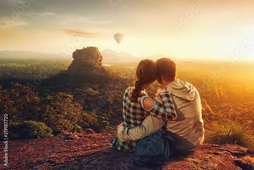 couple of travelers watch a beautiful sunset near the famous rocky plateau Lion peak, Sigiriya фототапет