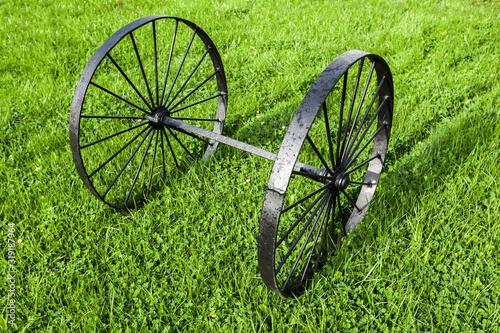 Photo Vintage black metal wheels on one axis