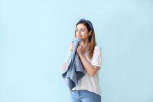 Beautiful Young Woman With Clean Towel After Laundry On Color Background