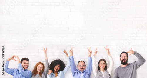 Fotografering Group of positive people showing funny gestures over white wall background