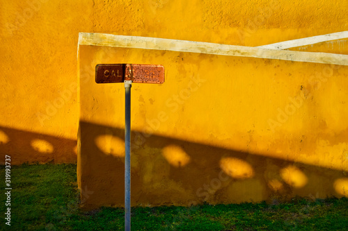 Fototapety, obrazy: Close-Up Of Rusty Information Sign Against Yellow Wall