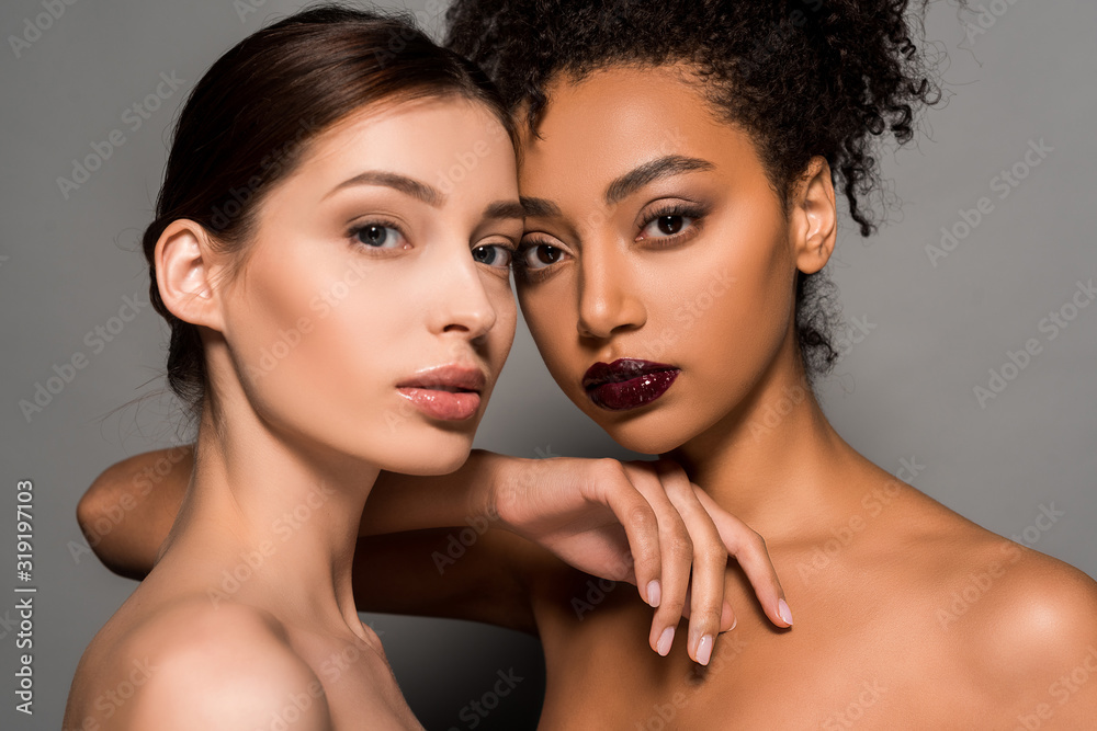 Fototapeta portrait of beautiful nude multicultural girls with perfect skin, on grey