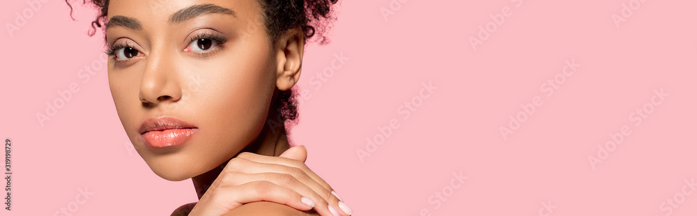 Fototapeta panoramic shot of beautiful african american girl with clean face, isolated on pink