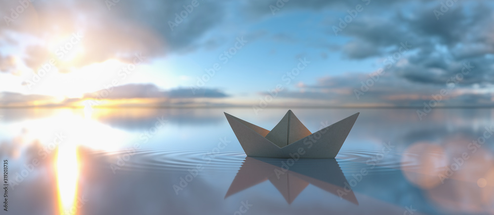 Fototapeta Paper boat in a calm water at sunrise sunset with cloudy sky, copyspace for your individual text.