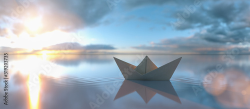 fototapeta na szkło Paper boat in a calm water at sunrise sunset with cloudy sky, copyspace for your individual text.