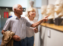 Couple Looking At Exhibits