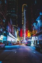 Street In Illuminated City At Night