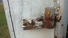 Close Up Of A Rusted Hinge Wit...