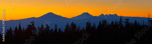 Fototapeta Colorful panoramic view after sunset with Mt Bachelor and Sisters Mountains near Bend in central Oregon. obraz