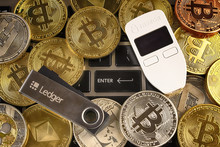 WROCLAW, POLAND - JANUARY 28, 2020: Physical Version Of Bitcoin (BTC), Trezor And Ledger (cryptocurrency Hardware Wallets) And Enter Button.