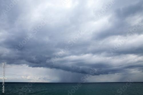 Storm clouds over the sea, horizon Wallpaper Mural