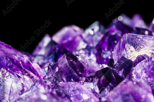 selective focus technique of healing amethyst purple crystal isolated on black Canvas Print